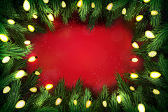 Christmas pine wreath with lights on festive background Stock Images