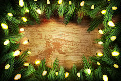 Christmas pine wreath  with lights on wooden background Royalty Free Stock Photo