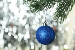 Christmas pinecone on christmas tree on lights background, close up Royalty Free Stock Photos