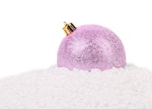 Christmas pink ball on a snow. Royalty Free Stock Photography