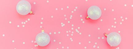 Christmas pink flat lay pattern with pearl balls. New Year or Christmas pattern flat lay top view Xmas holiday celebration pearl decorative toy balls sparkles royalty free stock photography