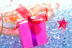 Christmas pink gift box with ribbon winter ice Stock Photo