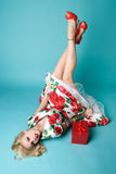 Christmas Pinup Girl. Beautiful pinup model with Christmas gift royalty free stock photos