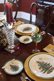 Christmas place setting. Table set for christmas with christmas plates and fine silverware Stock Photo