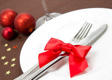 Christmas place setting. With red ribbon and decoration Stock Photos