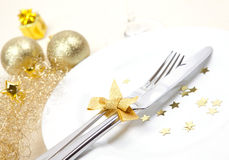 Christmas place setting. With golden ribbon and cutlery Royalty Free Stock Images