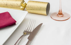 Christmas place setting with gold cracker Royalty Free Stock Photos