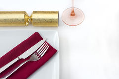 Christmas place setting with gold cracker Stock Photos
