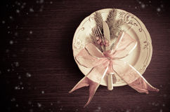Christmas place setting, plate, knive and fork. Christmas table place setting with christmas pine branches and plate, knife, fork and ribbon. Christmas holidays Royalty Free Stock Photography