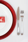 Christmas place setting with present Stock Photography