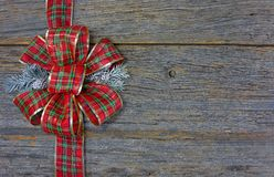 Christmas plaid bow on wood Royalty Free Stock Photos