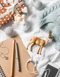 Christmas planning and shopping background. Blue knitted sweater, notepad, phone, christmas decoration on a light background, top. View. Christmas still life Royalty Free Stock Photo