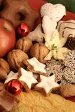 Christmas plate. Fruits with nuts and gingerbread Royalty Free Stock Images