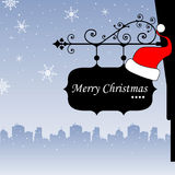 Christmas plate. Abstract colorful illustration with black plate hanging from a building and the text Merry Christmas written on the plate Royalty Free Stock Photo