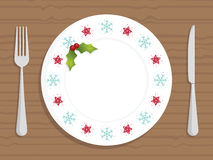 Christmas plate. White christmas plate with decorations and cutlery Royalty Free Stock Photo