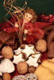 Christmas plate with angel. Nuts and gingerbread Stock Photos
