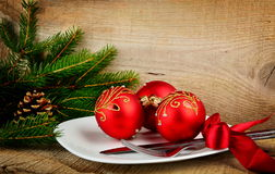 Christmas plate bauble pines wooden surface Royalty Free Stock Image