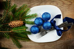 Christmas plate blue baubles pines wooden surface. Decorate christmas plate with blue baubles and pines on wooden surface Royalty Free Stock Images
