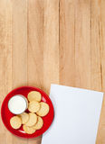 Christmas: Plate of Cookies and Blank Note. Background series of Christmas related items with lots of copyspace, on a wooden table setting Royalty Free Stock Photos