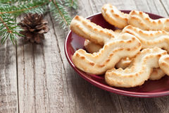 Christmas plate. With cookies on wooden table Stock Photo