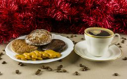 Gingerbreads and coffee. Christmas, plate with gingerbread and cup of coffee Stock Image
