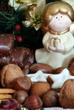 Christmas plate with little angel. Christmas plate with angel nuts and gingerbread Stock Images