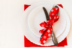 Christmas plate and silverware with red ribbon Stock Photography