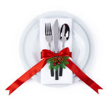 Christmas plate and silverware with red ribbon isolated on white Royalty Free Stock Images