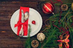 Christmas plate and silverware with red ribbon,  toned photo Stock Photos