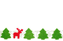 Christmas poatcard with fir-trees and red deer. Christmas postcard with line of red felt deer and fir-trees Royalty Free Stock Photos