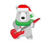 Christmas polar bear holds an electric guitar Royalty Free Stock Photo