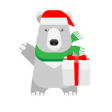 Christmas polar bear holds a gift box Royalty Free Stock Images