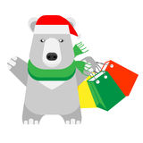 Christmas polar bear holds shopping bags Stock Photography