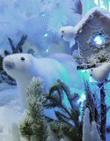 Christmas Polar Bear toy in the snow with lights Royalty Free Stock Images