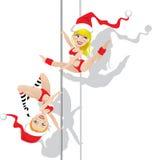 Christmas pole dancers Royalty Free Stock Image