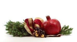 Christmas Pomegranate on White Royalty Free Stock Image