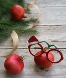 Christmas pomegranates spectacles red green white glasses with holiday decorative frame and fir tree branches on gray wooden stock photos