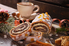 Christmas poppy seed cake with icing and snowflake sprinkles Royalty Free Stock Photos