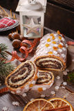 Christmas poppy seed cake with icing and snowflake sprinkles Royalty Free Stock Photography