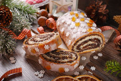 Christmas poppy seed cake with icing and snowflake sprinkles Royalty Free Stock Images