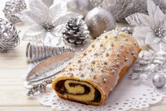 Christmas poppy seed roll cake on festive table. Royalty Free Stock Images