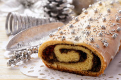 Christmas poppy seed roll cake on festive table. Royalty Free Stock Image