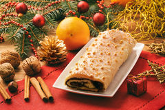 Christmas poppy seed roll cake on festive table. Stock Photo