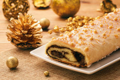 Christmas poppy seed roll on festive table. Stock Photography