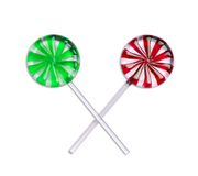 Christmas pops. A pair of red and green lollipops on white background (with path Stock Photos