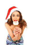 Christmas portrait. Young girl bites a santa claus candy Stock Images