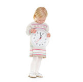 Christmas portrait of baby girl looking on clock Royalty Free Stock Photo