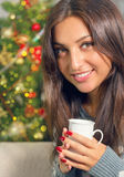 Christmas portrait of a beautiful smiling woman. Christmas portrait of a beautiful young smiling woman Stock Photography