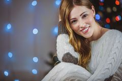 Christmas portrait of a beautiful young smiling woman. Photo indoors Royalty Free Stock Image