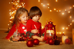 Christmas portrait of brother and sister at home Stock Photography